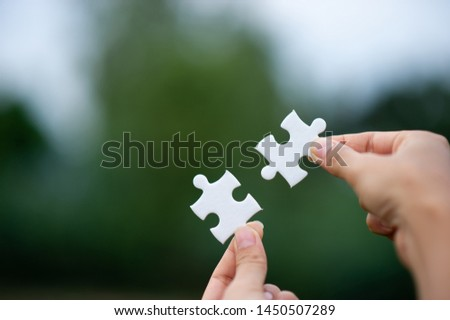 Hands and puzzles, important pieces of teamwork Teamwork concept #1450507289