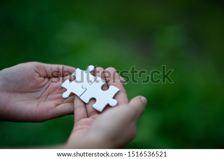 Hands and puzzles, important pieces of teamwork Teamwork concept #1516536521