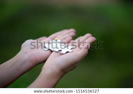 Hands and puzzles, important pieces of teamwork Teamwork concept #1516536527