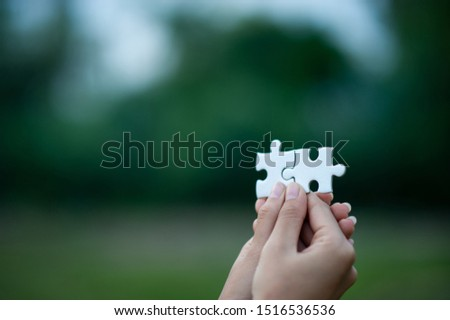 Hands and puzzles, important pieces of teamwork Teamwork concept #1516536536