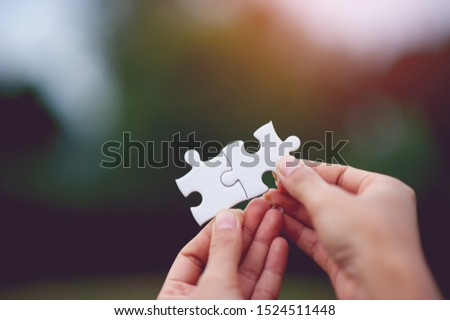Hands and puzzles, important pieces of teamwork Teamwork concept #1524511448