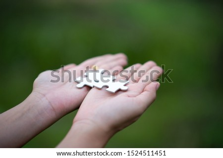 Hands and puzzles, important pieces of teamwork Teamwork concept #1524511451