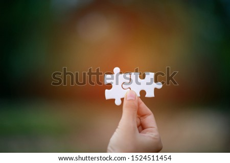 Hands and puzzles, important pieces of teamwork Teamwork concept #1524511454