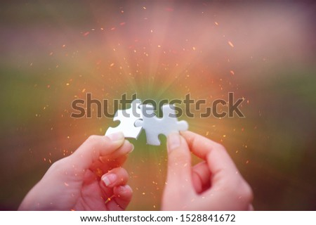 Hands and puzzles, important pieces of teamwork Teamwork concept #1528841672