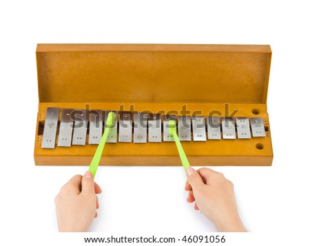 Hands and xylophone isolated on white background