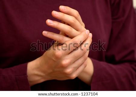 Hands applying cream
