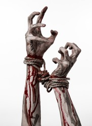 Hands bound,bloody hands, mud, rope, on a white background, isolated, kidnapping, zombie, demon