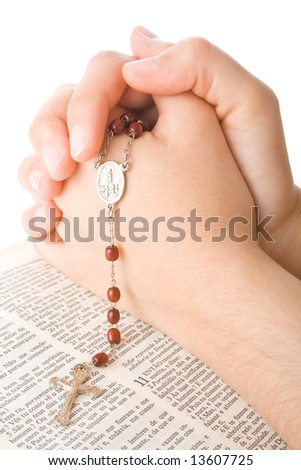 Hands closed in prayer with a rosary isolated on white background