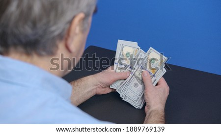 Hands counting US Dollar bills or paying in cash on money background. Concept of investment, success, financial prospects or career advancement. Foto stock ©