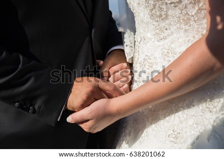 Hands detail with wedding rings exchange, during a wedding #638201062
