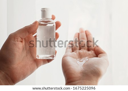Hands disinfection. Hands with disinfecting alcohol gel and sanitizer bottle, prevent virus epidemic. Prevention of flu disease and coronavirus. Cleaning and disinfecting hands in proper way.