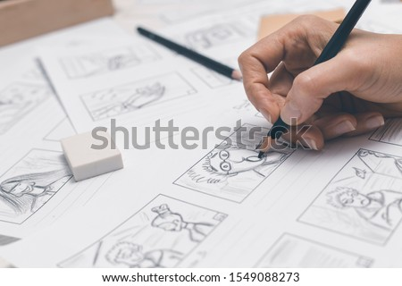 Hands draw a storyboard for the film. Foto stock ©