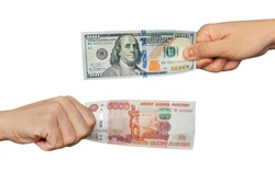 Hands exchange rubles for dollars. People exchange currency, hands transmit money. Hand holds ruble and dollar banknotes. Isolated on white background. purchase of foreign currency