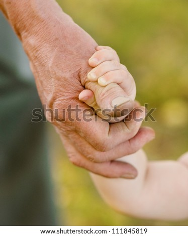 hands family grandson and old grandfather