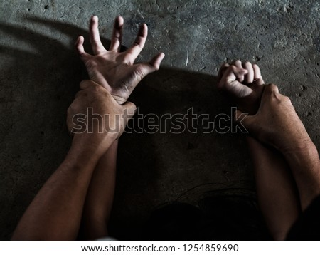 Hands for rape and sexual abuse concept.Sexual abuse is a problem or Social issues concept. Man's hand holding a woman hand for rape and sexual abuse.