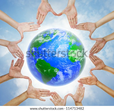 Hands forming  a circle with planet Earth in center and sky background