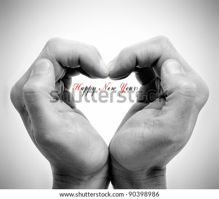 hands forming a heart and the sentence happy new year