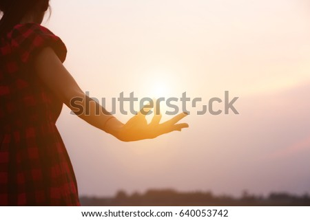 hands forming a shape with sunset silhouette - Shutterstock ID 640053742