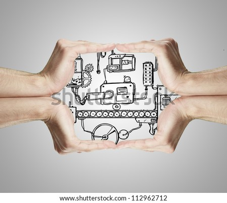 hands frame and drawing abstract mechanism - stock photo