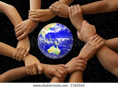 Hands framing the earth in a global team theme