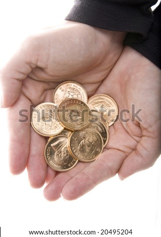 Hands full of one Ounce gold Krugerrand coins from South Africa isolated on white.