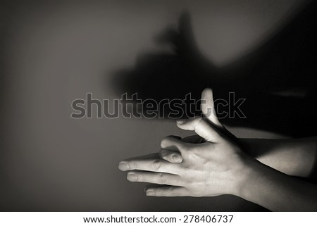 Hands gesture like dog face on gray background #278406737