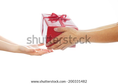 Hands giving and receiving a present