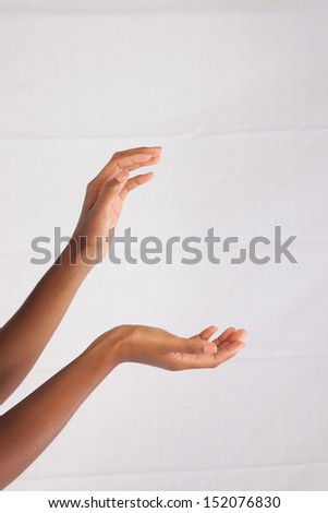 Hands gracefully reaching out and cupped as if grabbing something