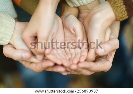 Hands held together on a natural background