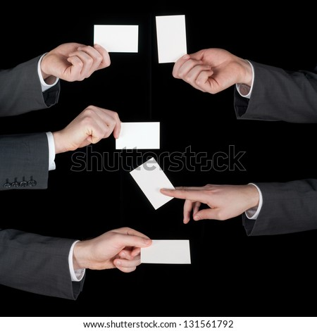 Hands hold business cards collage on black background