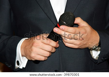 hands hold microphone