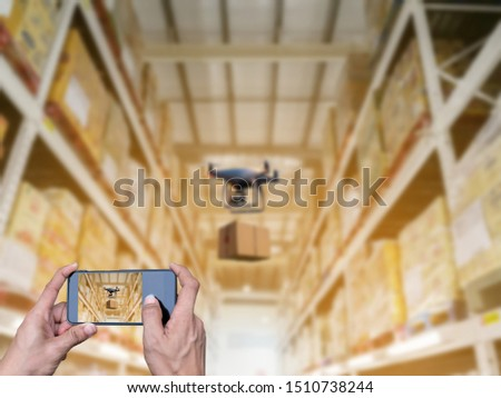 hands hold smart phones Industrial stock storage products storage system by drone unmanned aircraft