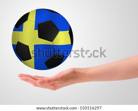 Hands holding a ball with flag of sweden