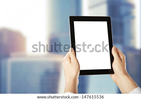 hands holding a blank  tablet - Shutterstock ID 147615536