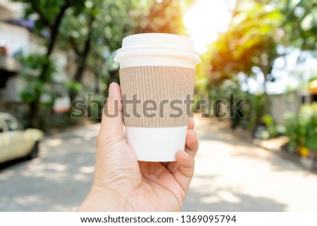 Hands holding a coffee cup that can be recycled, Coffee is one of the most popular drinks. Free space can put picture text to create an advertising media.