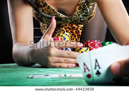 hands holding a deck of playing cards