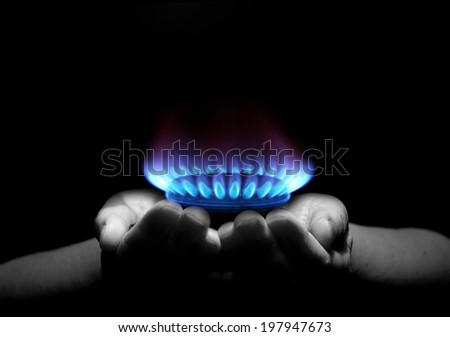 Hands holding a flame gas stock photo