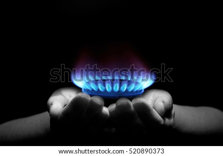 Hands holding a flame gas #520890373