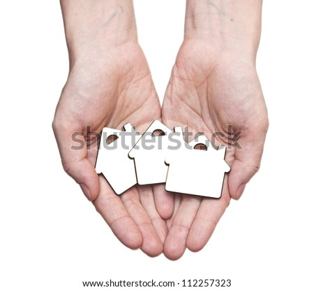 Hands holding a home sign, Real Estate Concept