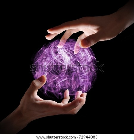 Hands holding a magical orb.