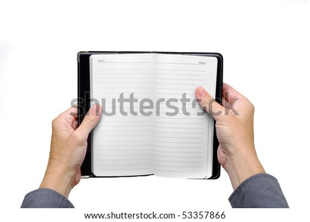 hands holding a notebook - stock photo