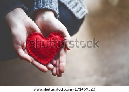 hands holding a soft heart shape #171469520