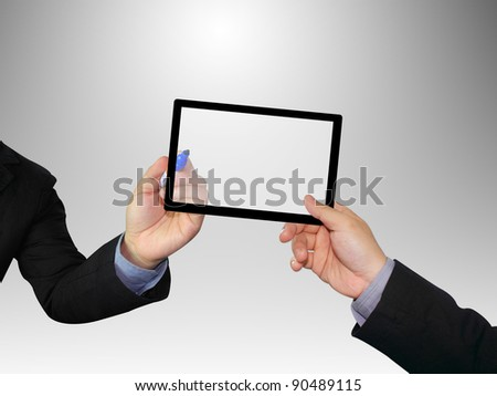 Hands holding a tablet with clipping path