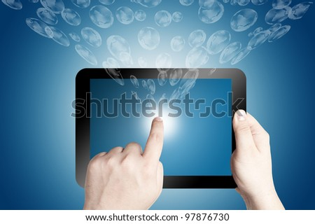 Hands holding and point on digital tablet with 3D globe icon coming from the screen on blue background