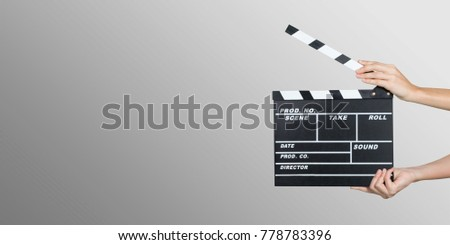 Hands holding clapper board