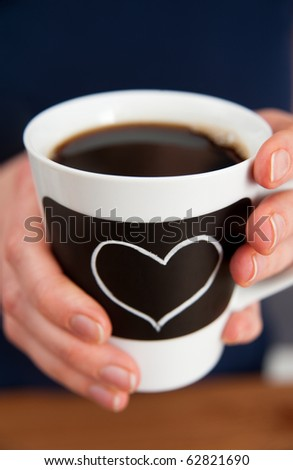 Hands Holding Coffee Cup with Chalk Heart
