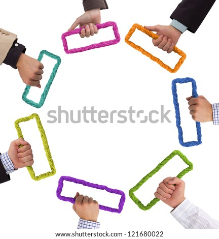 Hands holding colorful bricks forming a circle