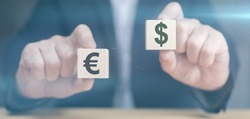 Hands holding cubes with dollar and euro icon. Currency concept. businessman's hands hold two wooden cubes with dollar and euro sign. businessman chooses euro or dollar signs