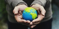Hands holding earth illustration ball