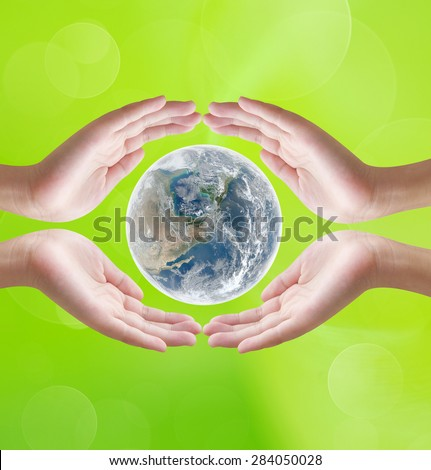Hands holding earth  on green bokeh background , concept design , Elements of image are furnished by NASA